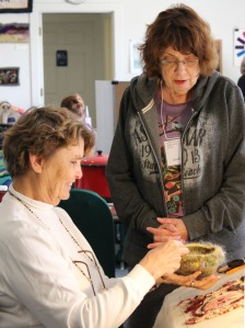 Miriam Lastine and Gail Becker discuss Gail's 'fiber bowl'