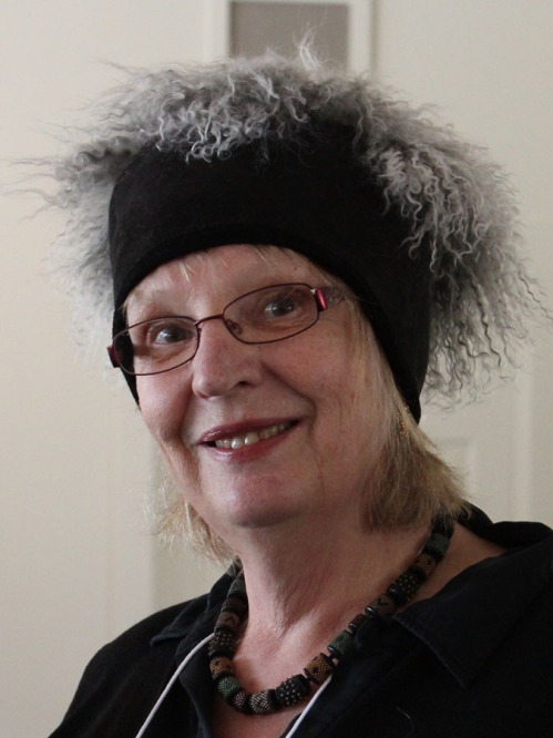 Susan Bradford models one of her lambskin hats