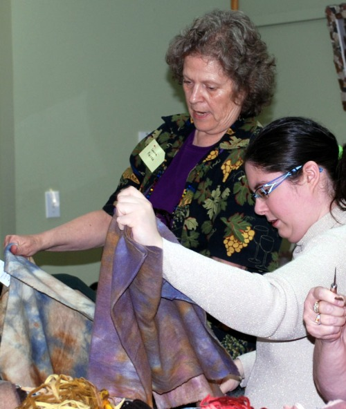 Laura and Melissa select wool.