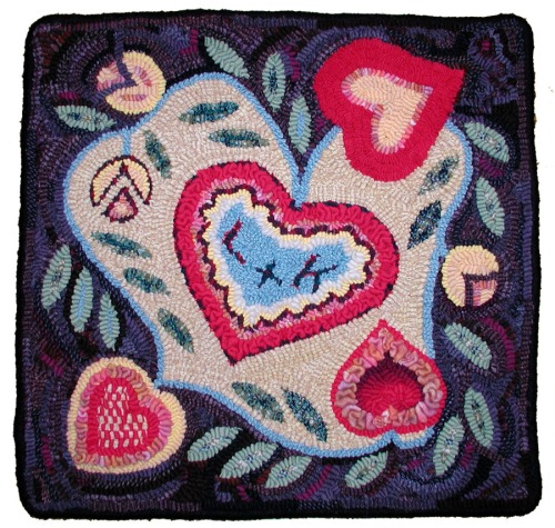 'Hearts & Tulips' design by Corrine Bridge hooked by Laura Pierce