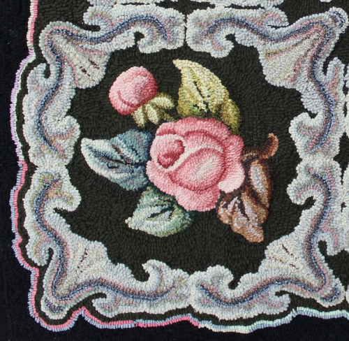 close-up of rose and scroll on Ione's mother's rug