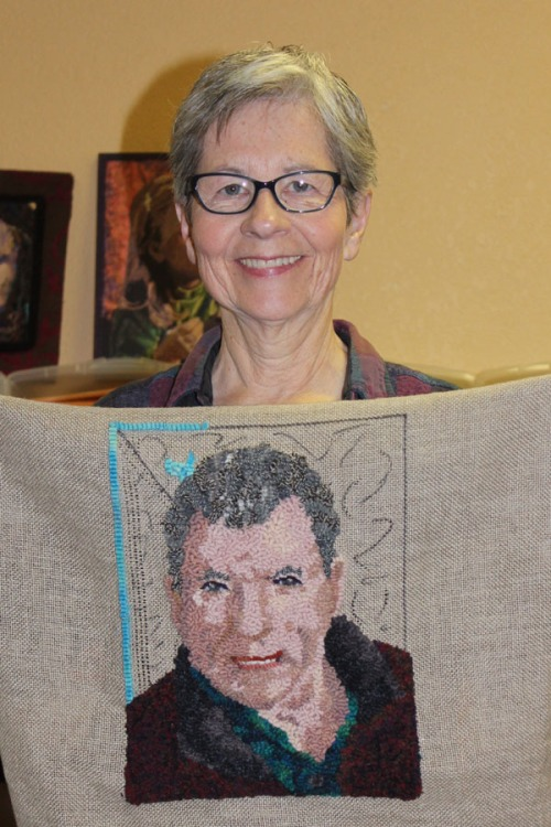 Chris  and her portrait rug of her husband