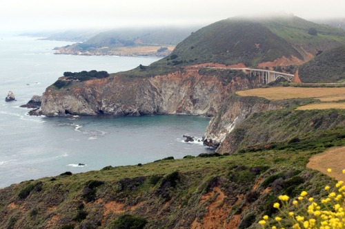 Big Sur view of cliffs and a bridge.