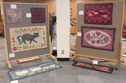 A few of Polly Clark's rugs at the WTW 2016 rug show